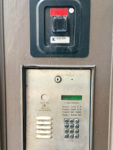 This is the keypad to the left of the entry door. You'll use it to let me know you've arrived.